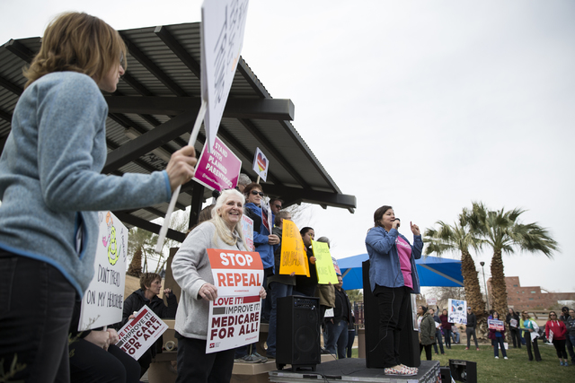 Raquel Cruz-Juarez, organizer for Planned Parenthood, speaks in front of health care advocates protesting changes to the Affordable Care Act during a rally at Heritage Park on Saturday, Feb. 25, 2 ...