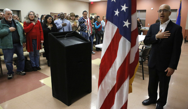 Nevada State Sen. Mo Denis, right, leads the pledge of allegiance during a Nevada Hispanic Caucus event where they spoke about immigration rights at the East Las Vegas Community Center on Saturday ...