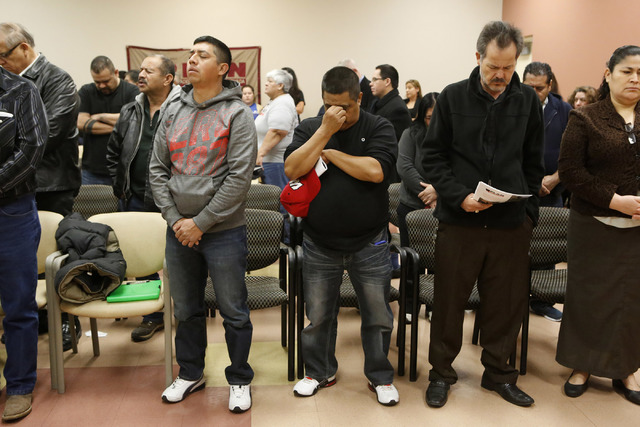 People pray before a Nevada Hispanic Caucus event at the East Las Vegas Community Center on Saturday, Feb. 18, 2017, in Las Vegas. (Christian K. Lee/Las Vegas Review-Journal) @chrisklee_jpeg
