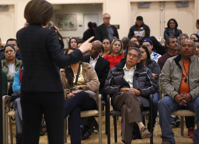 A large crowd listens to U.S. Senator, D-Nev, Catherine Cortez Masto as she speaks to them about about immigration rights during a Nevada Hispanic Caucus event at the East Las Vegas Community Cent ...