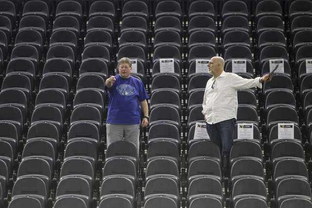 Todd Semel, left, and Tony Locorriere, prospective season ticket members from Las Vegas, compare available seats during the Vegas Golden Knights 24-hour open house event at T-Mobile Arena, Tuesday ...
