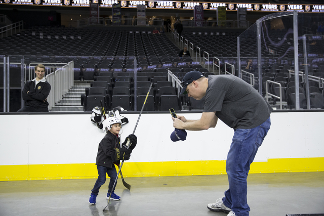 Troy Teske of Las Vegas takes a photo of his 3-year-old son Nick during the Vegas Golden Knights 24-hour open house event at T-Mobile Arena, Tuesday, Feb. 21, 2017, in Las Vegas. The event was ope ...