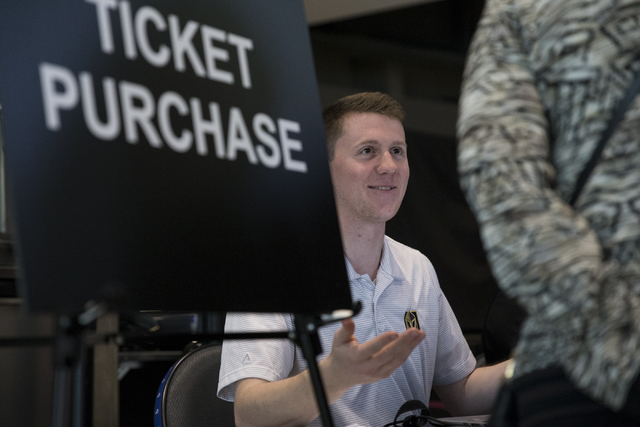 Tom Heimrich, account executive for ticket services, assists prospective season ticket members during the Vegas Golden Knights 24-hour open house event at T-Mobile Arena, Tuesday, Feb. 21, 2017, i ...