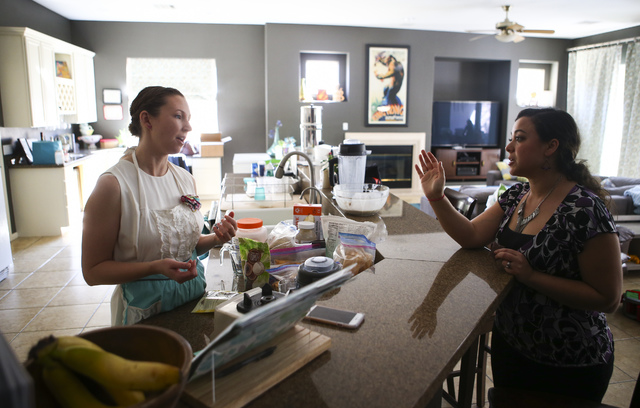 Brittany Henderson, left, and Samantha Bell taste oatmeal cinnamon raisin lactation cookies before they go in the oven at Henderson's home in the Summerlin area of Las Vegas on Wednesday, Feb. 1,  ...