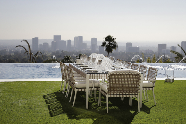 This Thursday, Jan. 26, 2017, photo shows an outdoor dining area next to an 85-foot infinity swimming pool overlooking Los Angeles at a $250 million mansion in the Bel-Air area of Los Angeles. At  ...