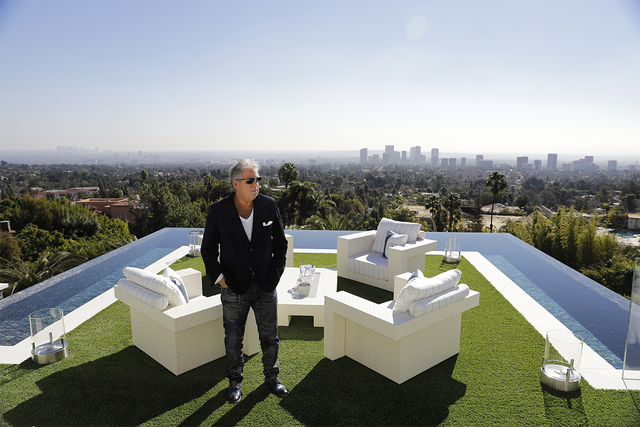 In this Thursday, Jan. 26, 2017, photo, developer Bruce Makowsky poses for a photo on the balcony off the master bedroom of a $250 million mansion he built in the Bel-Air area of Los Angeles. The  ...