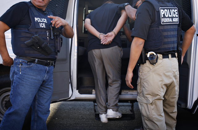 ICE agents arrest thirty-nine-year-old Jose Martinez Cornejo in Las Vegas on Sept. 24, 2010 during a three day ICE Fugitive Operation. (John Locher/Las Vegas Review-Journal)