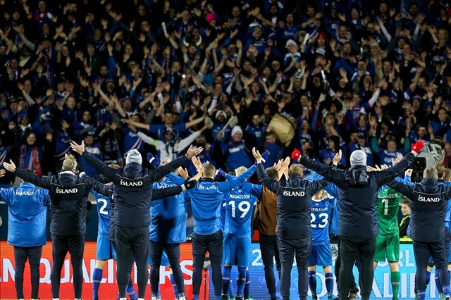 """Iceland celebrates with fans by doing the popular """"Viking War Chant."""" (Courtesy of Iceland Communications)"""
