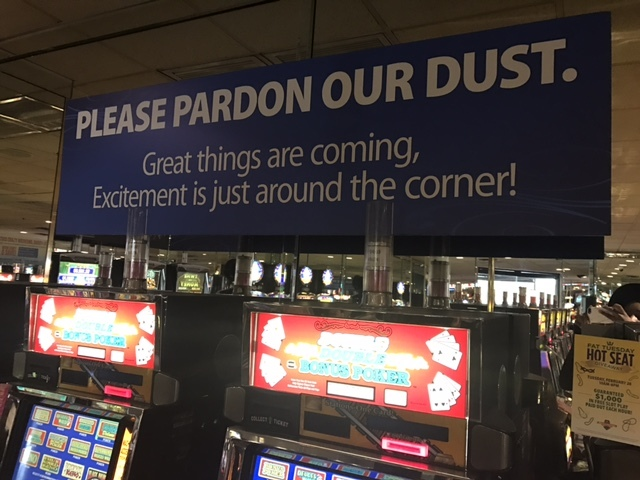 A sign near slot machines inside the Palace Station notifies guests about the reinvestment project that will bring new additions to the casino. (Kailyn Brown/View) @kailynhype