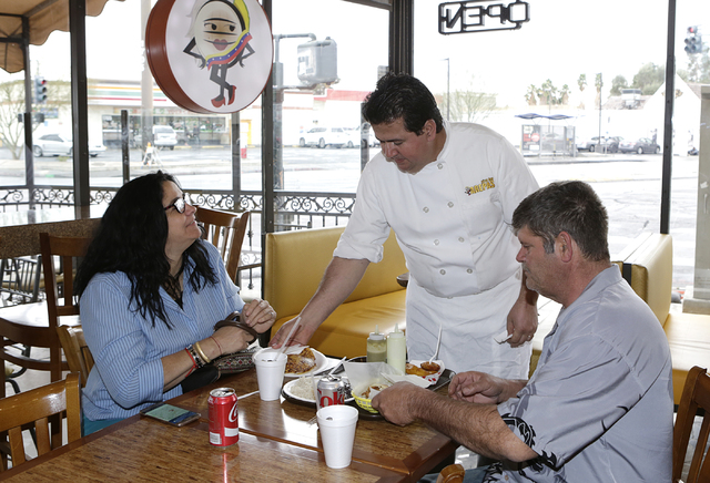 Viva Las Arepas restaurant owner, Felix Arellano, serves his customers at his restaurant at 1616 S. Las Vegas Blvd. on Friday, Feb. 17, 2017, in Las Vegas. (Bizuayehu Tesfaye/Las Vegas Review-Jour ...