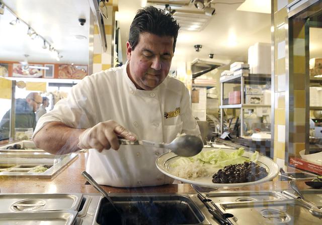 Viva Las Arepas restaurant owner, Felix Arellano, prepares an order at his restaurant at 1616 S. Las Vegas Blvd. on Friday, Feb. 17, 2017, in Las Vegas. (Bizuayehu Tesfaye/Las Vegas Review-Journal ...