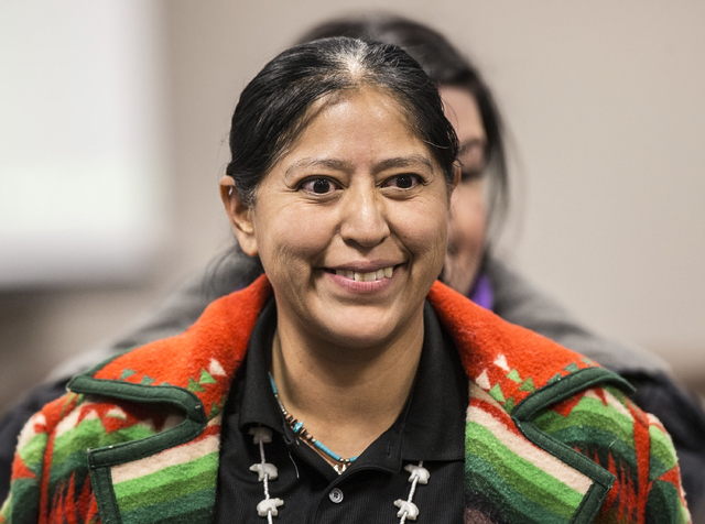 Raquel Arthur greets friends before the start of a Senate Government Affairs Committee meeting to discuss a resolution to replace Columbus Day with Indigenous People Day at the Nevada Legislative  ...