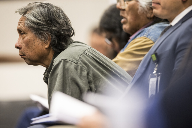 Joe Bryan, a member of the Washoe Tribe, listens to officials on the Senate Government Affairs Committee discuss a resolution to replace Columbus Day with Indigenous People Day at the Nevada Legis ...