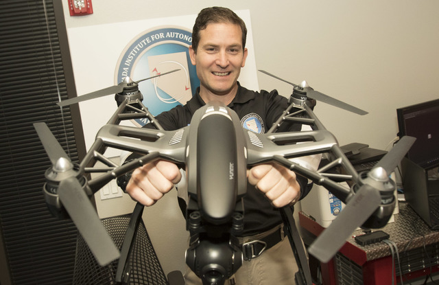 Dr. Chris Walach, director of operations of unmanned aviation for Nevada Institute for Autonomous Systems, poses with a Yuneec Q500 4K quadcopter at his office in Las Vegas on Wednesday, Aug. 31,  ...