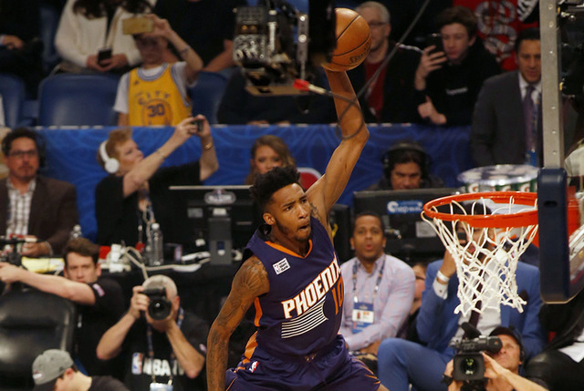 Phoenix Suns forward Derrick Jones Jr. (10) leaps over four people to make a dunk during the slam-dunk contest as part of the NBA All-Star Saturday Night events in New Orleans, Saturday, Feb. 18,  ...