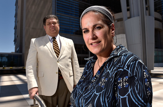 Vivian Wright-Bolton, right, stands with her attorney, Cal Potter III, on steps leading to the Lloyd George U.S. Courthouse on July 28, 2015, in Las Vegas. (David Becker/Las Vegas Review-Journal)