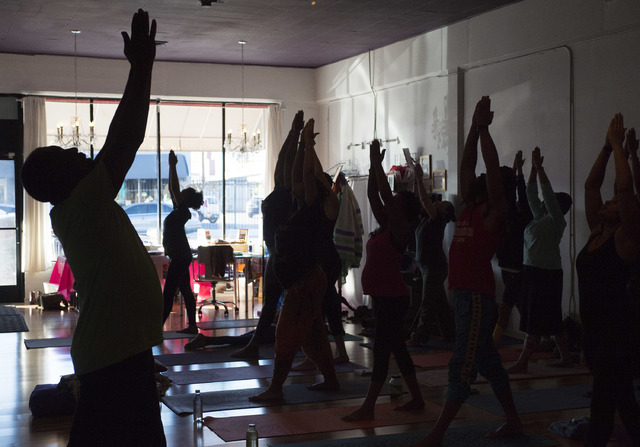 Yirser Ra Hotep, left, leads yogis at Sin City Yoga in Las Vegas through a Kemetic yoga sequence, working toward positions seen in ancient Egyptian carvings. (Bridget Bennett/Las Vegas Review-Jour ...