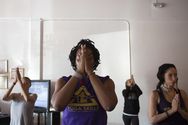 Maticia Sudah, center, organized the Kemetic yoga workshop taught by Yirser Ra Hotep at Sin City Yoga on February 4 and 5. Ra Hotep trained Sudah as a Kemetic yoga instructor. (Bridget Bennett/Las ...