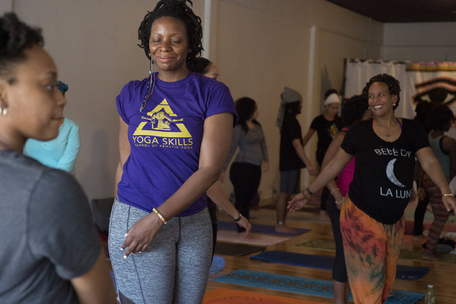 Kemetic yoga focuses on releasing tensions in the body and bringing the mind in harmony with the universe's plan. (Bridget Bennett/Las Vegas Review-Journal) @bridgetkb
