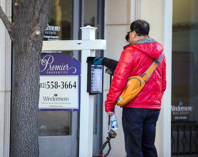 A person looks at a price list for million-dollar homes at Lake Las Vegas outside the Windermere real estate office at MonteLago Village on Tuesday, Dec. 20, 2016. (Las Vegas Review-Journal)