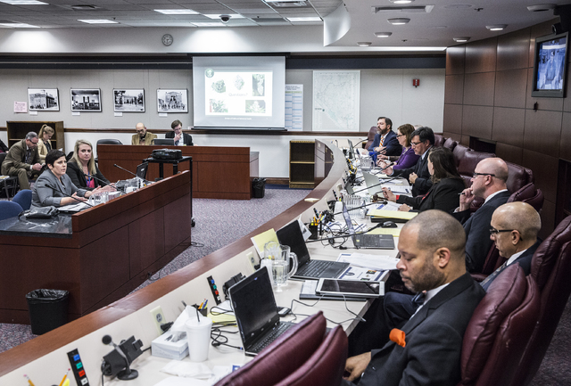 Deonne Contine, left, executive director of the Nevada Department of Taxation, presents to the Senate Judiciary Committee during a hearing on the implementation of regulations for recreational mar ...