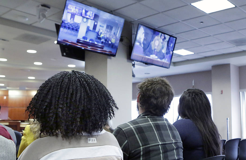 Child advocates watch at the Grant Sawyer State Office Building as Assemblywoman Ellen Spiegel testifies via satellite video in support of Assembly Bill 113, on Monday, Feb. 27, 2017, in Las Vegas ...