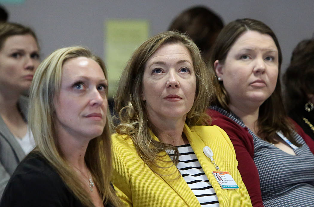 Suzie Owens, left, Holly Lyman, and Katie Ryan watch at the Grant Sawyer State Office Building as Assemblywoman Ellen Spiegel, testifies via satellite video in support of Assembly Bill 113, on Mon ...