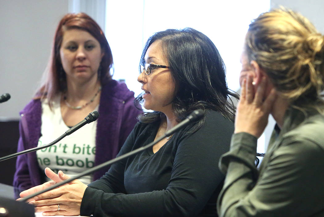 Seven months pregnant, Meghan Trahan, center, testifies in support of Assembly Bill 113, as Rosemary Casillas, left, and Autumn Wake look on at the Grant Sawyer State Office Building Monday, Feb.  ...