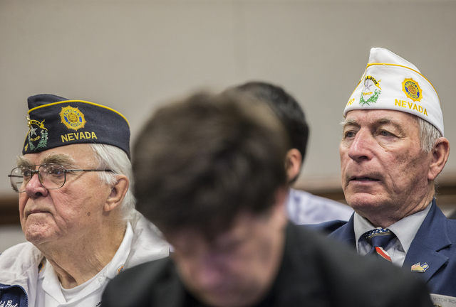 Navy veteran Mitch Roach, right, listens to testimony during a Senate Government Affairs Committee meeting on the third day of the Nevada Legislative session on Wednesday, Feb. 8, 2017, at the Leg ...