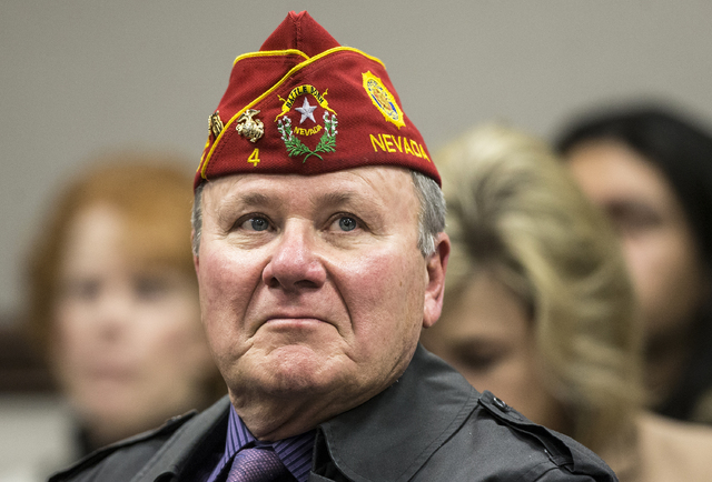 Marine Corps veterans John F. Warden listens to comments from the Senate Government Affairs Committee during the third day of the Nevada Legislative session on Wednesday, Feb. 8, 2017, at the Legi ...