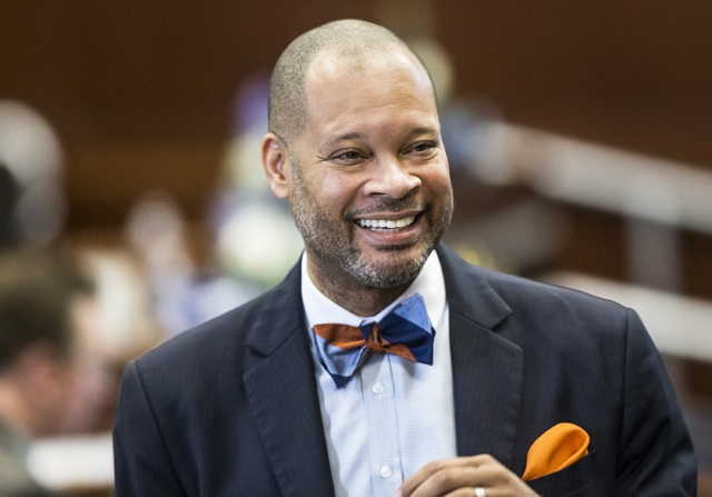 Senate Majority Leader Aaron Ford, D-Las Vegas, interacts with colleagues in the Senate Chambers during the third day of the Nevada Legislative session on Wednesday, Feb. 8, 2017, at the Legislati ...