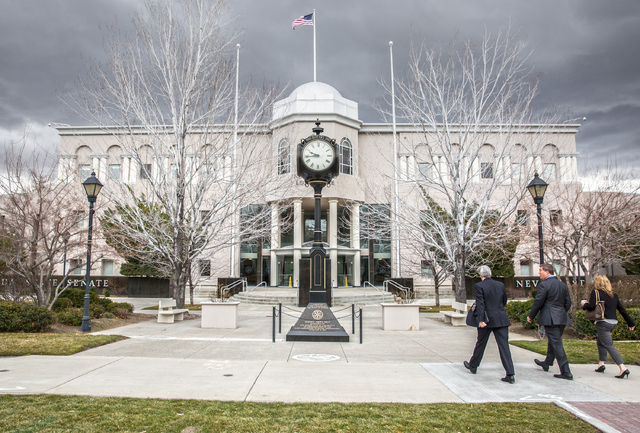 Legislators walk into the Legislative Building during the fourth day of the Nevada Legislative session on Thursday, Feb. 9, 2017, in Carson City. (Benjamin Hager/Las Vegas Review-Journal) @benjami ...