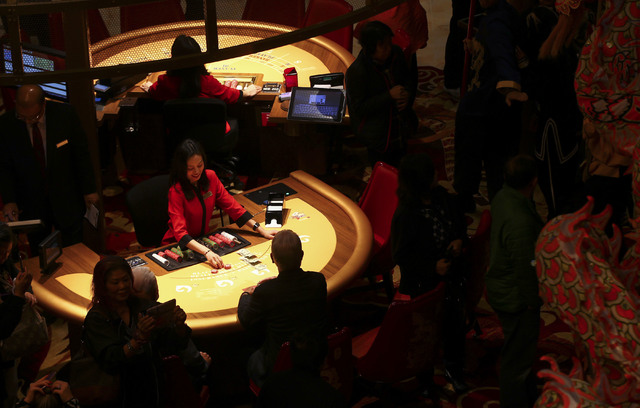 People gamble during the grand opening of the Lucky Dragon hotel-casino in Las Vegas on Saturday, Dec. 3, 2016. (Chase Stevens/Las Vegas Review-Journal) @csstevensphoto