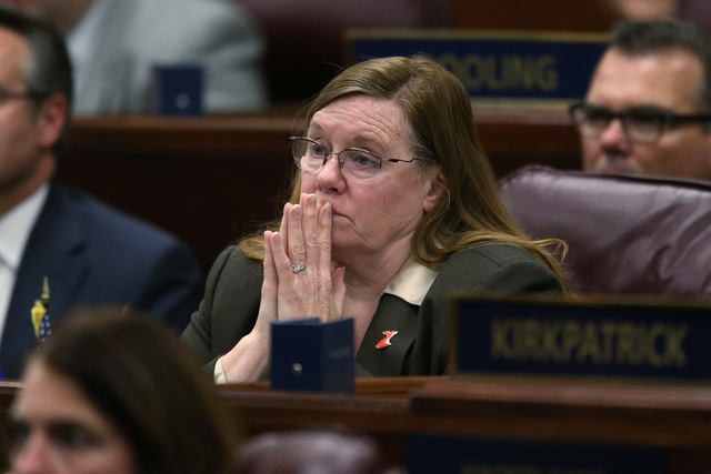 Nevada Assemblywoman Maggie Carlton, D-Las Vegas, listens as Gov. Brian Sandoval delivers his State of the State address at the Legislative Building in Carson City, Nev., on Thursday night, Jan. 1 ...