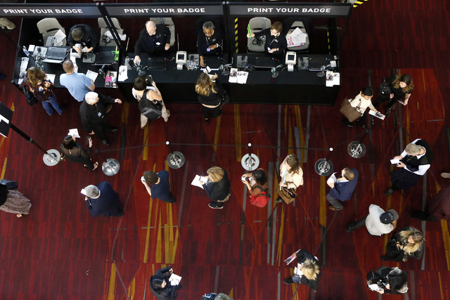People register for the MAGIC fashion convention at the Las Vegas Convention Center on Tuesday, Feb. 21, 2017, in Las Vegas. (Christian K. Lee/Las Vegas Review-Journal) @chrisklee_jpeg