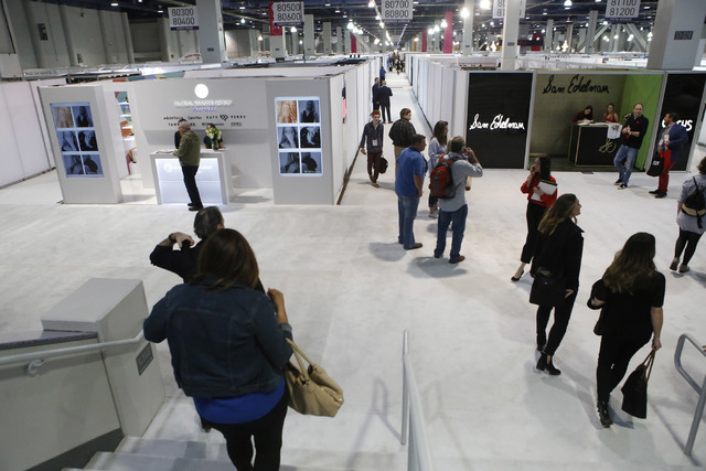 People browse various retail vendors during the MAGIC fashion convention at the Las Vegas Convention Center on Tuesday, Feb. 21, 2017, in Las Vegas. (Christian K. Lee/Las Vegas Review-Journal) @ch ...
