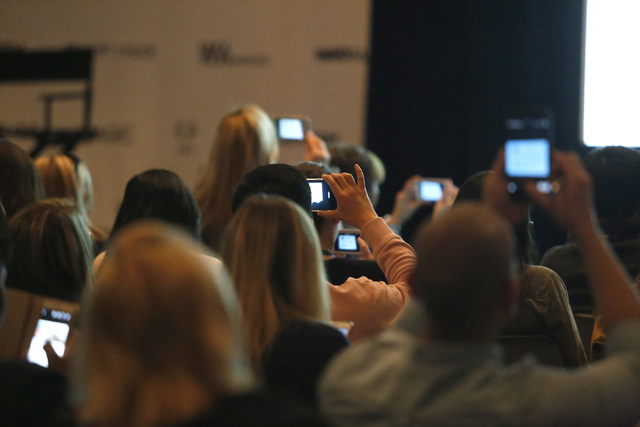 People take photos of a fashion trend  presentation during the MAGIC fashion convention at the Las Vegas Convention Center on Tuesday, Feb. 21, 2017, in Las Vegas. (Christian K. Lee/Las Vegas Revi ...