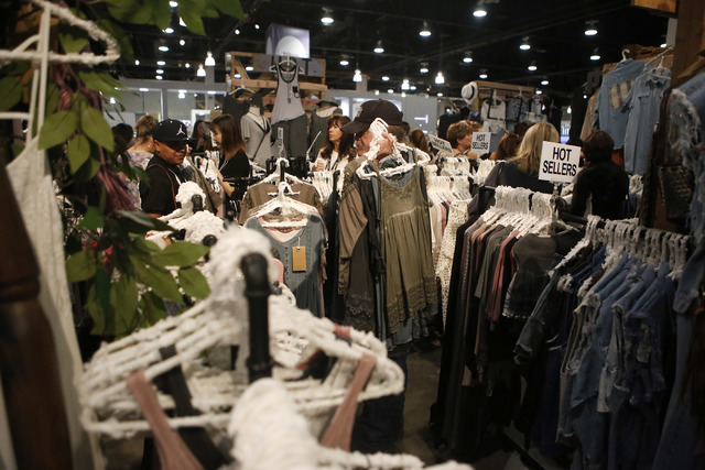 People browse through clothes during the MAGIC fashion convention at the Las Vegas Convention Center on Tuesday, Feb. 21, 2017, in Las Vegas. (Christian K. Lee/Las Vegas Review-Journal) @chrisklee ...