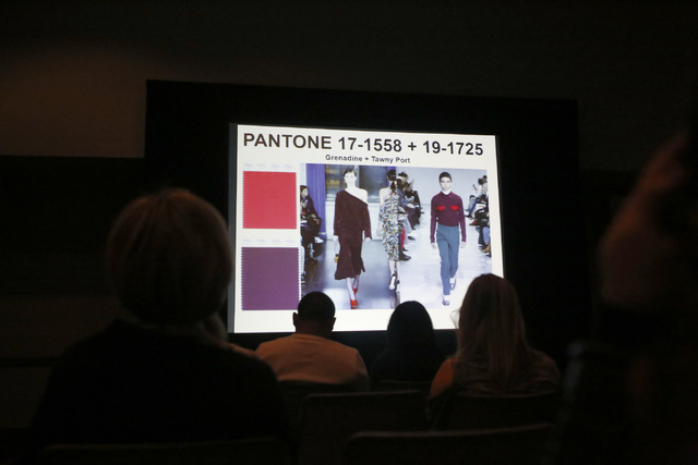 People watch a pantone color presentation during the MAGIC fashion convention at the Las Vegas Convention Center on Tuesday, Feb. 21, 2017, in Las Vegas. The presentation featured trendy colors an ...
