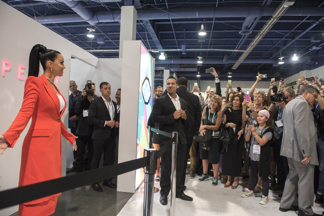 Musical artist Katy Perry greets the crowd from her booth during the MAGIC trade show inside the Las Vegas Convention Center on Monday, Aug.15, 2016. Martin S. Fuentes/Las Vegas Review-Journal