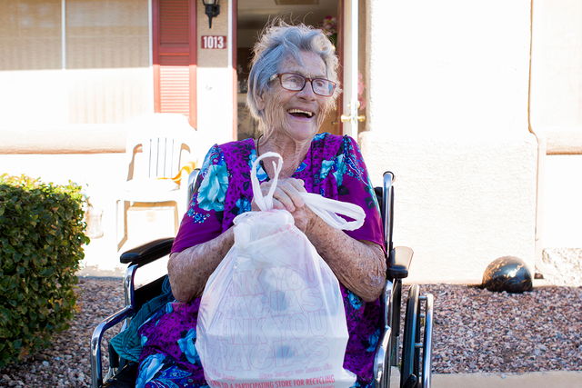 Betty Hurd holds a meal that was delivered to her at her home by volunteers in Henderson in this 2016 file photo. (Elizabeth Page Brumley/Las Vegas Review-Journal) @EliPagePhoto