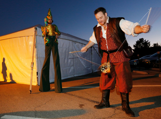 Zackory Pattee of Las Vegas, right, performs during a medieval feast at UNLV Catholic Newman Center in Las Vegas, Sunday, Jan. 29, 2017, as Jake Taylor of Las Vegas looks on. (Chitose Suzuki/Las V ...