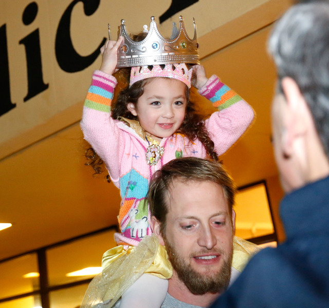 Justin Micatrotto of Las Vegas carries her daughter Gemma, 3, on his shoulder during a medieval feast at UNLV Catholic Newman Center in Las Vegas, Sunday, Jan. 29, 2017. (Chitose Suzuki/Las Vegas  ...