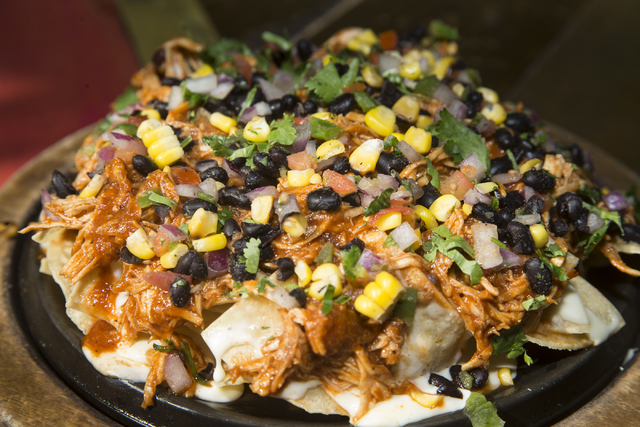 "The ""Dirty Bird Nachos"", named for the Atlanta Falcons in advance of their Super Bowl appearance, at Nacho Daddy restaurant on Thursday, Jan. 26, 2017, in Las Vegas. The nachos a ..."