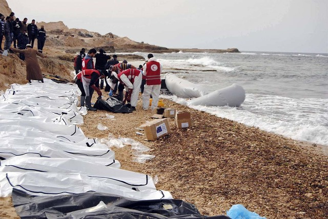 This Monday, Feb. 20, 2017, photo provided by The International Federation of Red Cross and Red Crescent Societies, shows the bodies of people that washed ashore and were recovered by the Libyan R ...