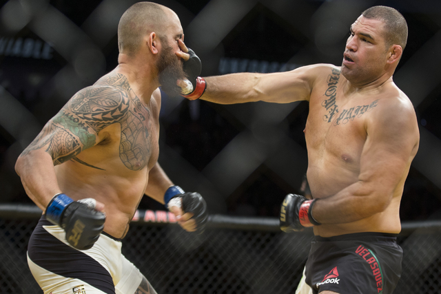 Cain Velasquez, right, connects a right hand against Travis Browne in the heavyweight bout during UFC 200 at T-Mobile Arena on Saturday, July 9, 2016, in Las Vegas. Velasquez won by technical knoc ...