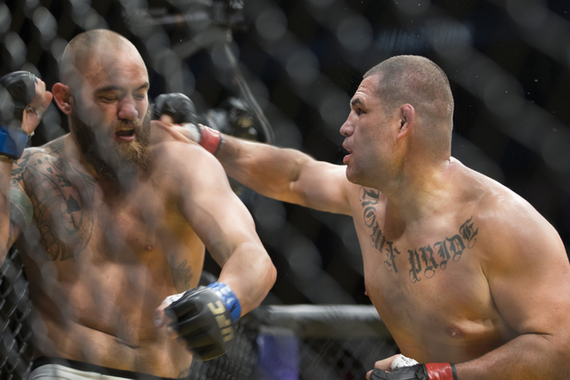 Cain Velasquez, right, connects a right punch against Travis Browne in the heavyweight bout during UFC 200 at T-Mobile Arena on Saturday, July 9, 2016, in Las Vegas. Velasquez won by technical kno ...