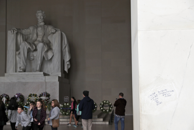 Graffiti is seen on the Lincoln Memorial, Tuesday, Feb. 21, 2017, in Washington. U.S. Park Police spokeswoman Sgt. Anna Rose said that the messages written in permanent marker were discovered over ...