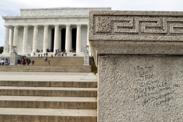Graffiti is seen near the steps of the Lincoln Memorial, Tuesday, Feb. 21, 2017, in Washington. U.S. Park Police spokeswoman Sgt. Anna Rose said that the messages written in permanent marker were  ...