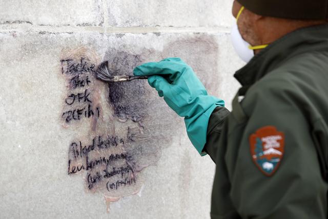 A U.S. Park Service employee cleans graffiti off of the Washington Monument, Tuesday, Feb. 21, 2017, in Washington. (Alex Brandon/AP)